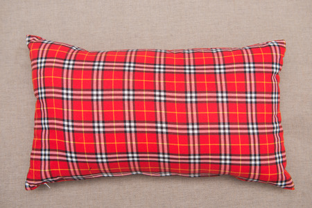 red plaid: red plaid pillow on sofa in bedroom
