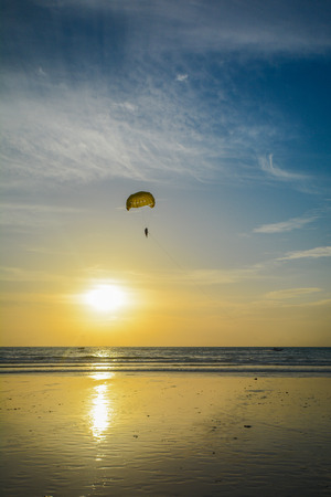 time to shine: paragliding over the sea in the sunset time, shine Stock Photo