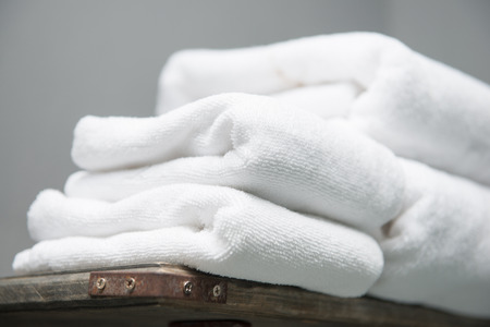 white towel placed on shelves in bathroom of hotel, fabric