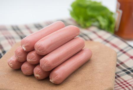 hot dog sausages on wood pad, food