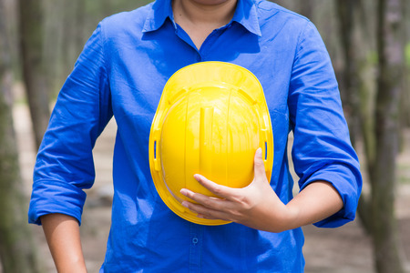 yellow hard hat: yellow hard hat in Construction Site, worker