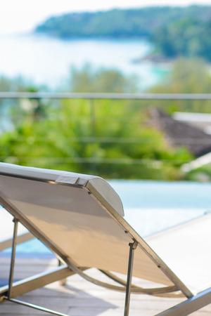 beach chairs: white beach chairs by the pool, villa