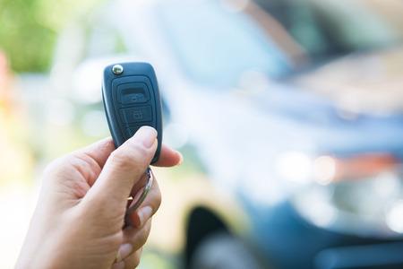 open autocar auto: woman pressed on the remote to open the car, auto