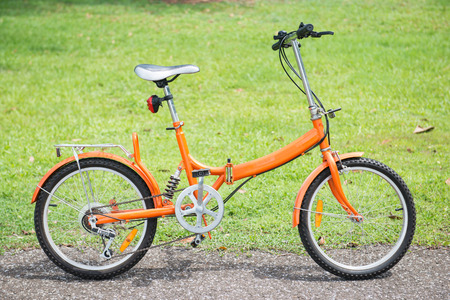 folding: orange folding bicycles in park, bike