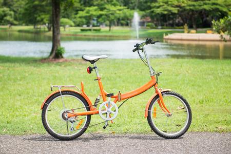 orange folding bicycles in park, bike
