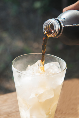 sparking: pouring cola sparking water into cup, drink