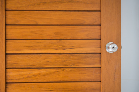 doorknob on the wood door in home Stock Photo