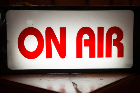 light box: On Air light box signs in front of radio station, label