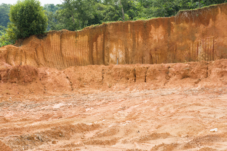 red soil: laterite soil excavation site for sale, construction Stock Photo