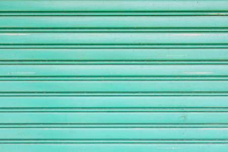 shutter door: green metallic roller shutter door for wallpaper, material Stock Photo