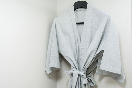 house robes: gray bathrobe hanging in the closet, clothing