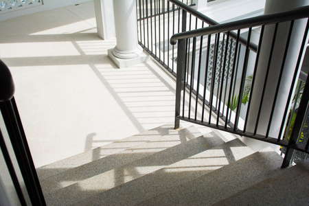 handrails: Stone staircase with black iron handrails, architecture
