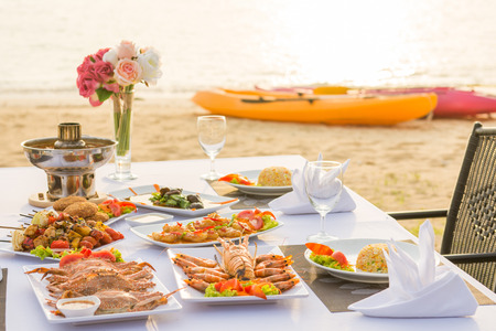 light meal: barbecue seafood for dinner by the sea, sunset Stock Photo