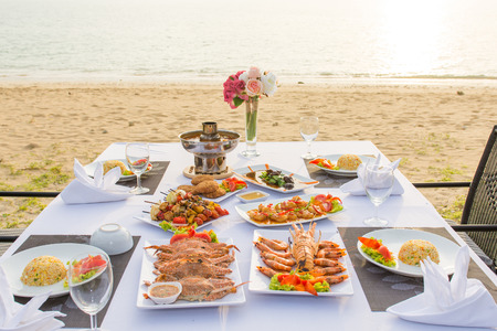 barbecue seafood for dinner by the sea, sunset Stock fotó