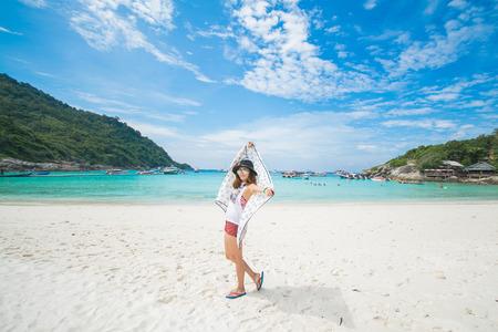 Woman happy when her travel to Racha Island, Phuket Thailand, nature