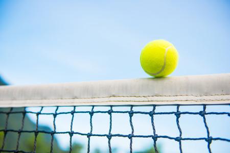 tennis ball with net Фото со стока