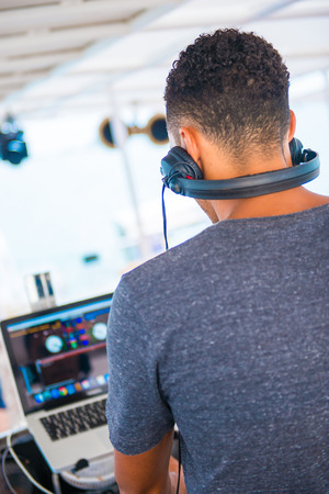spins: young Dj spins the music on the yacht, party