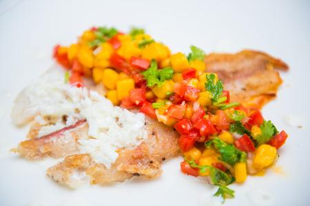 mango fish: fish steak with mango sauce and tomatoes, food