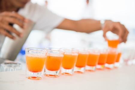 shot: fresh orange juice in shot glasses, drink