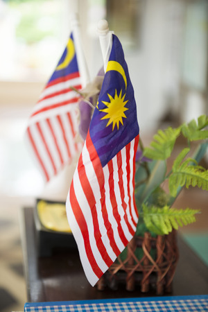 small Malaysia flag in building, anthems Stock Photo