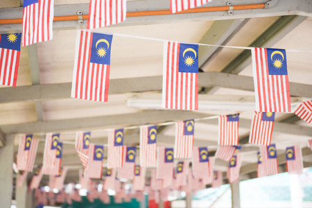 small Malaysia flag in building, anthems Stock fotó