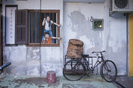 GEORGETOWN, PENANG, MALAYSIA-AUGUST 9, 2015 street art on wall in george town world heritage in Penang, Malaysia, Travel