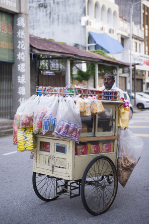 sales person: PENANG, MALAYSIA-AUGUST 10, 2015 :: Local Food Truck in Penang, Malaysia, goods