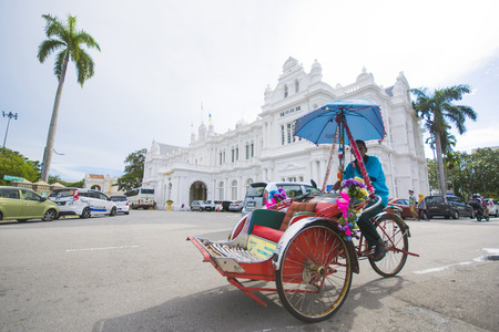 penang: Penang, Malaysia - August 10-2015 :: three-wheeler in front of Penang State Museum & Art Gallery in George Town Malaysia Editorial