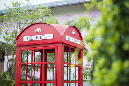 trees services: traditional red phone booth, callbox