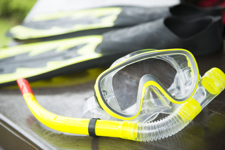 snorkelling: yellow snorkelling mask and flipper, dive