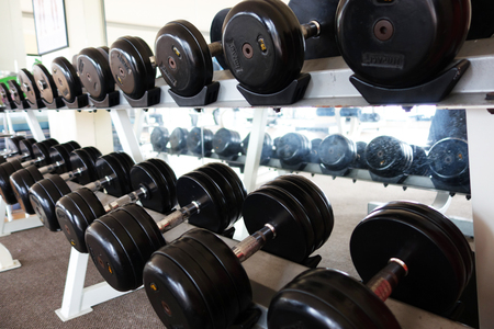 dumbbells for weight lifting in fitness room, exercise