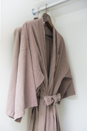 bathrobes: brown bathrobes hanging in wardrobe, closet