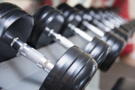 weight room: dumbbells for weight lifting in fitness room, exercise