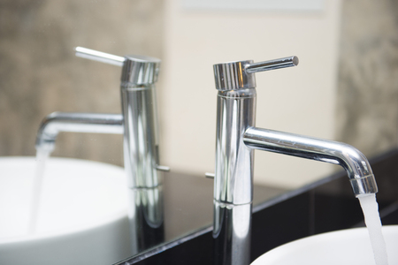 bowl sink: Open water from the faucet in the basin, bathroom