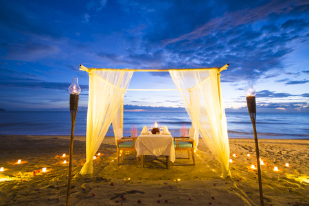 dining set: dinner set up on the beach, romantic