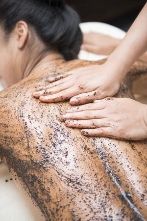 massage with coffee scrub by therapists, scrub