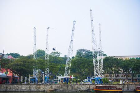 reverse: CLARK QUAY, SINGAPORE - OCTOBER 12, 2015: G- Max Reverse Bungee at Clark Quay, Singapore on October 12, 2015, action