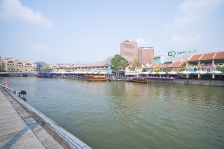 tourist boat cruising the Singapore river at Clarke Quay, travel