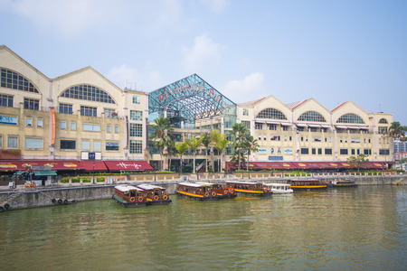 quay: tourist boat cruising the Singapore river at Clarke Quay, travel