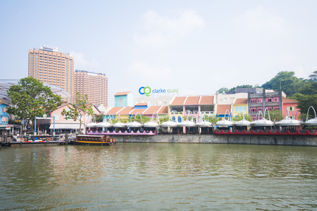 cruising: tourist boat cruising the Singapore river at Clarke Quay, travel