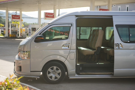 phangnga: PHANG-NGA, THAILAND - November 7, 2015; van parked waiting passenger within the Shell gas station at Phang-nga, Thailand on November 7, 2015, transportation Editorial