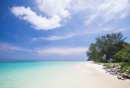 ton: tropical beach with blue sky and calm blue sea surf, Mai Ton Island, Phuket, Thailand Stock Photo