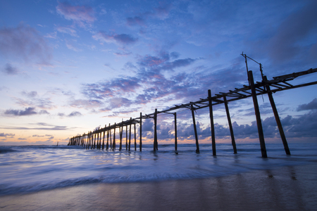 phangnga: old wooden bridge in Natai beach with beautiful sky at twilight time, Phang-nga