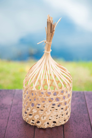 basket weaving: round bamboo basket on the table, Thai basket