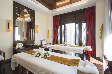 retreats: spa room with towel swans on the bed, relaxation Editorial
