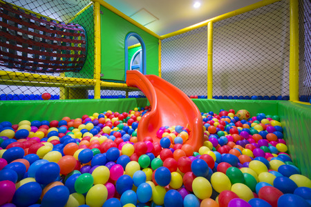 play room: play room with colorful balls at hotel, kid Stock Photo
