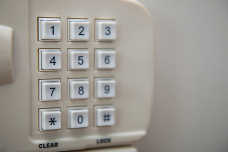 secret code: number keypad on the safety box, button