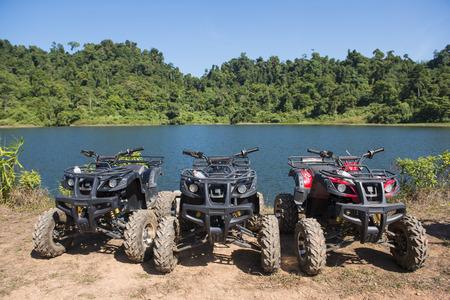 lakeside: ATVs car parked lakeside, extreme Stock Photo