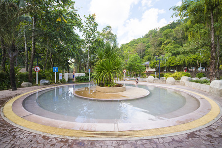 located: RANONG, THAILAND - JANUARY 23, 2016 : Raksa Warin hot spring is located in a park in Ranong on January 23, 2016, Thailand