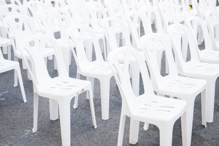 outdoor event: row of white plastic chairs in outdoor event, seat